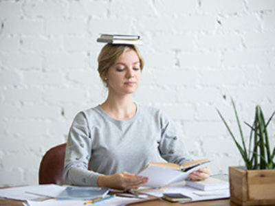 Woman Feeling Balanced At Her Office Desk