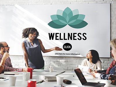 Wellness-coach-speaking-to-office