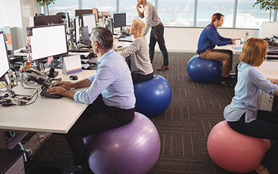 workers-sitting-on-exercise-balls